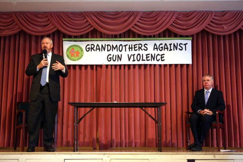 Seattle Mayor Mike McGinn, left, speaks alongside candidate Ed Murray during a candidate debate on gun violence sponsored by Grandmothers Against Gun Violence. Photographed on Tuesday, October 15, 2013 at Mount Zion Baptist Church in Seattle.  (Joshua Trujillo, seattlepi.com) Photo: SEATTLEPI.COM