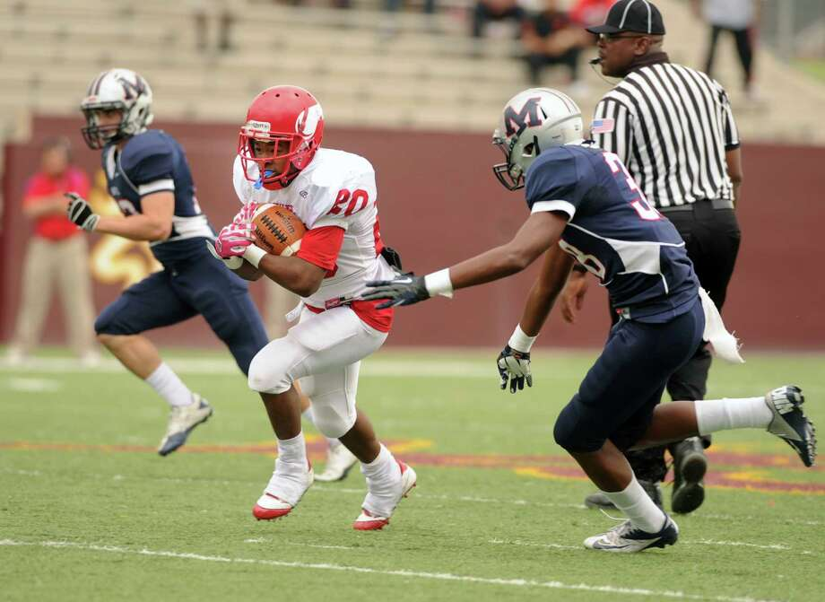 Dulles running back Remus Bulmer has covered a lot of geography this season, rushing for at least 116 yards in four games, including 334 against Clements and 276 against Terry. Photo: Eddy Matchette, Freelance / Freelance