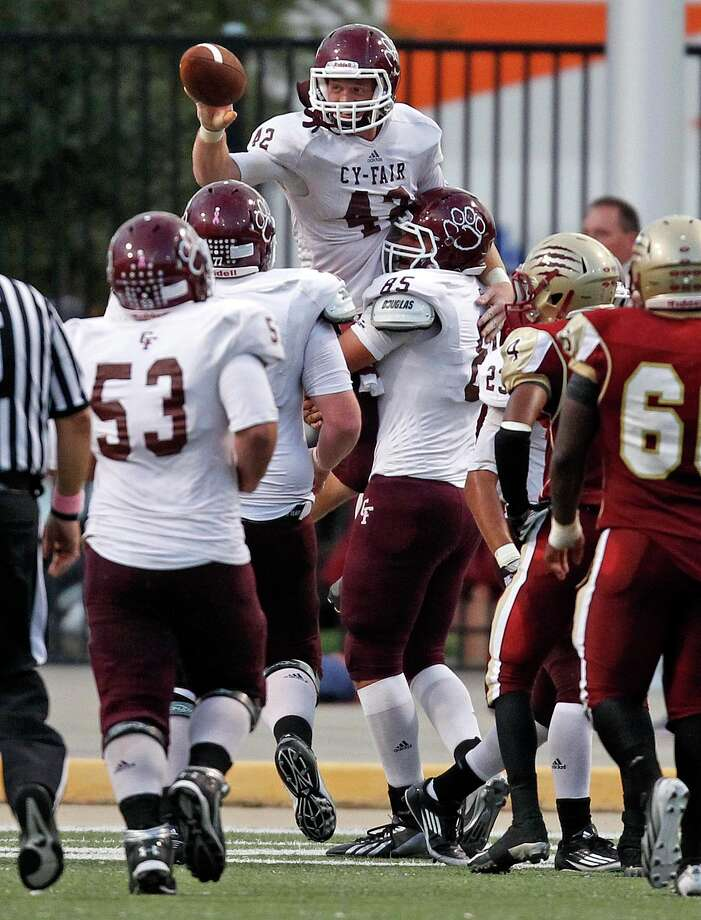 Cy-Fair's Drew Tobler (42) celebrates his 26-yard touchdown reception with teammates during the Bobcats' 30-23 win over Cy Woods last week at the Berry Center. Photo: Eric Christian Smith, Freelance