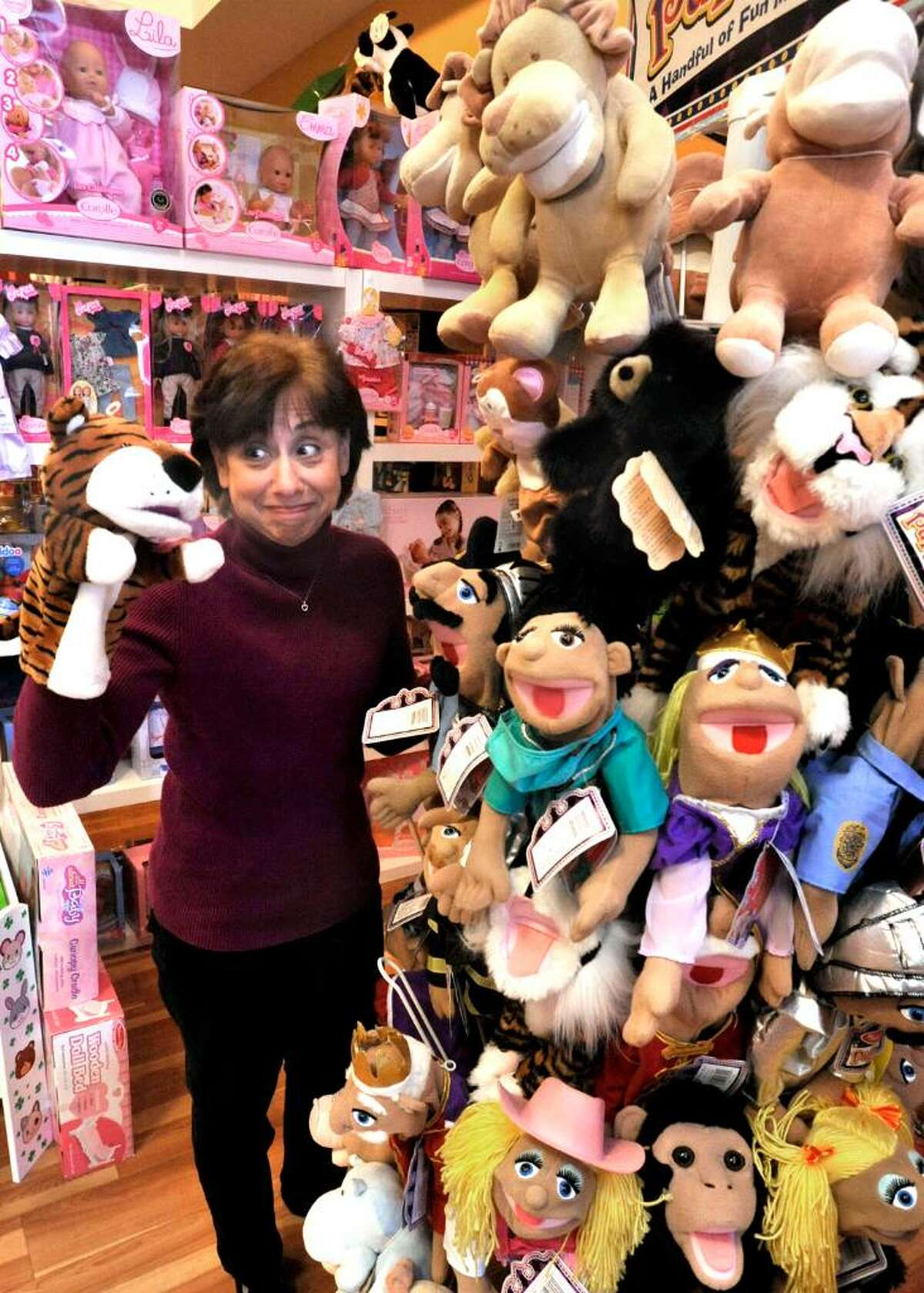 Debbie Zeldis,playing with the puppets, in her Southbury business, Toy Journey, on Friday, Jan.22,2010.