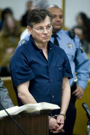 John Michael Farren, 57, of New Canaan, Conn, is arraigned in state Superior Court in Norwalk, Conn,  Thursday, Jan. 7, 2010. Farren, a onetime top attorney to former President George W. Bush is accused of trying to kill his wife at their Connecticut home by beating her with a flashlight and choking her. Farren, 57, is charged with strangulation and attempted murder. Photo: Kerry Sherck / Stamford Advocate