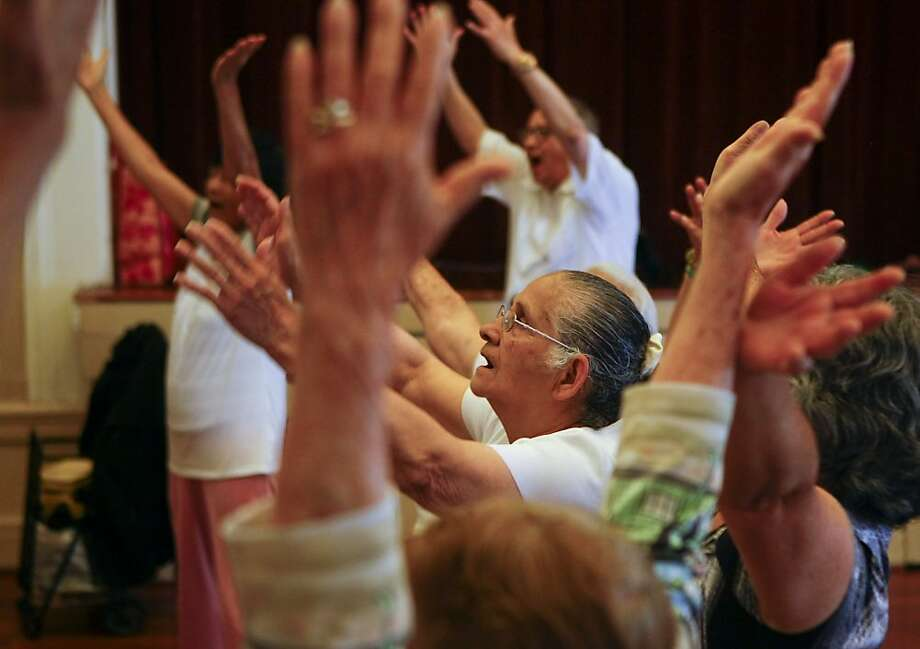 Amanda Arteaga takes part in warm-up vocal exercises with the Community of Voices choir at Mission Neighborhood Center. Photo: Raphael Kluzniok, The Chronicle