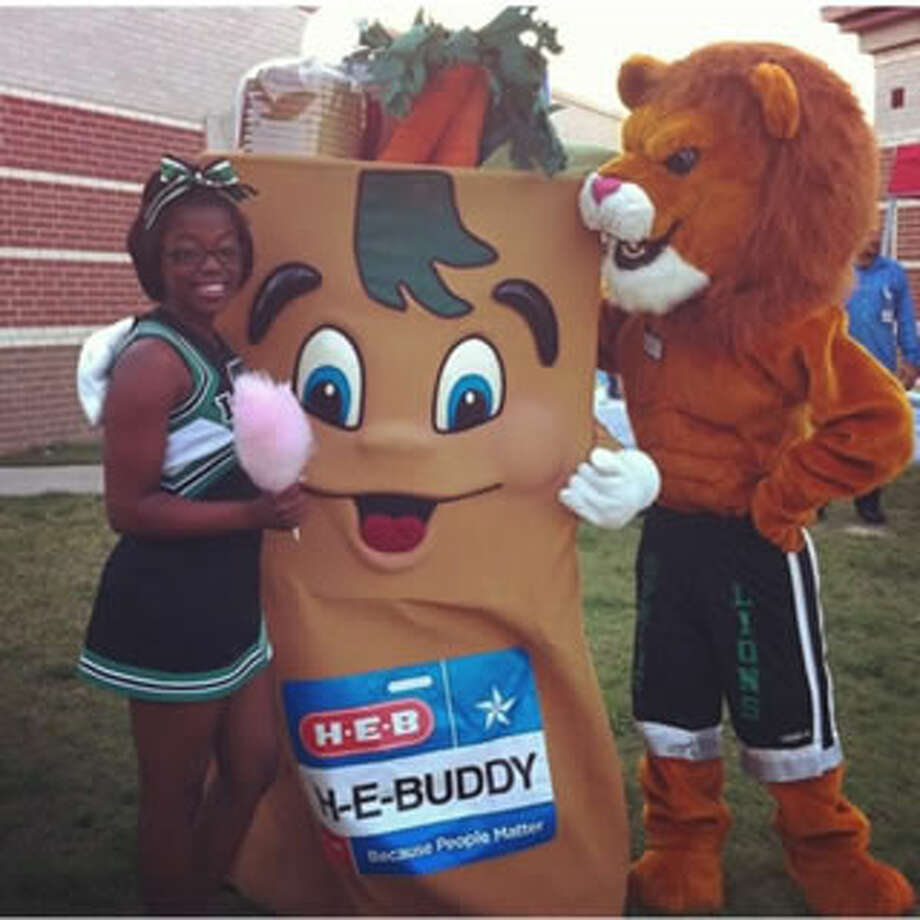 Spring High School cheerleader Christian Thurman and Leo the Lion Mascot Brandon Lawson have been invited to perform in the pregame show of the Capitol One Bowl on New Year's Day. Photo: Provided By Spring High School