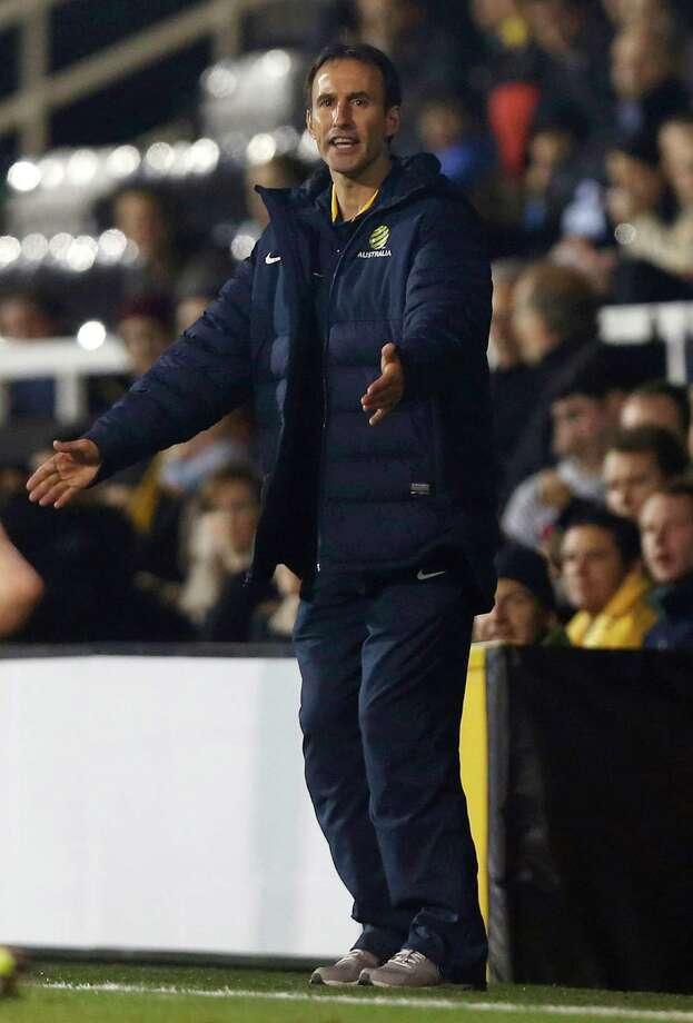Australia's acting head coach Aurelio Vidmar reacts as he watches his team play against Canada during their international soccer match at Craven Cottage, London, Tuesday, Oct. 15, 2013. (AP Photo/Sang Tan) ORG XMIT: LST117 Photo: Sang Tan / AP