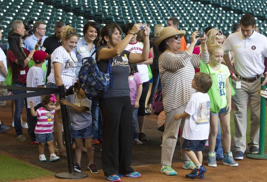 Friends and family take photos of the event. Photo: Cody Duty, Houston Chronicle