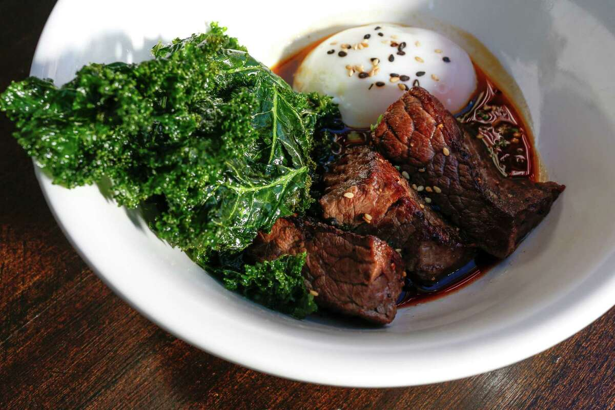Brisket with Waygu brisket, fried kale, poached egg and citrus duck demi at Oct. 10, 2013 in Houston at Goro & Gun restaurant. (Eric Kayne/For the Chronicle)