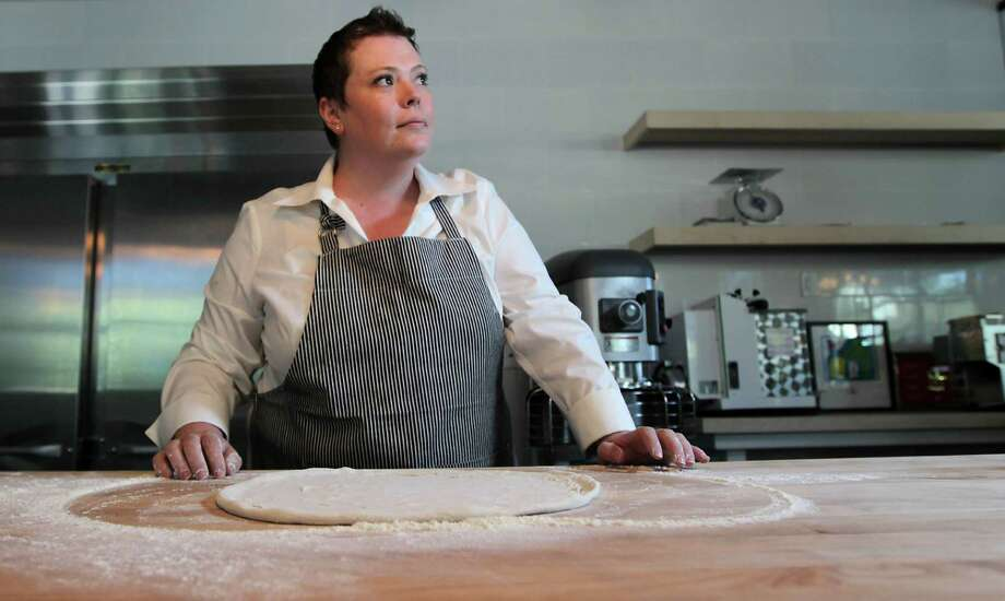 "Coppa OsteriaExecutive chef Brandi Key works in Coppa Osteria's Dough Room. ""It's what we do: It's about hands and touching things and working from the heart,"" she says.But if she's feeling the pressure of opening Coppa Osteria - the 