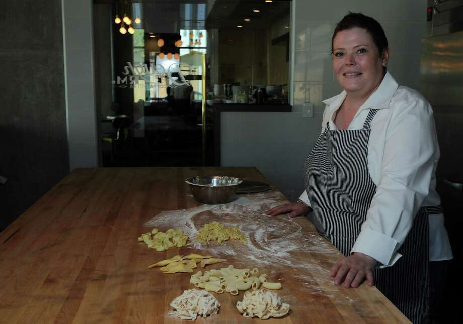 """Executive chef Brandi Key works in Coppa Osteria's dough room. """"It's what we do: It's about hands and touching things and working from the heart,"""" she says. Photo: James Nielsen, Staff / © 2013  Houston Chronicle"""