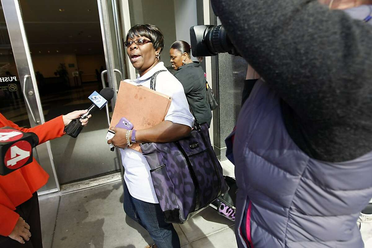 SEIU Negotiator Antoinette Bryant says hello to reporters as she heads into BART negotiations at the State of California Department of Transportation in Oakland, CA Tuesday, October 15, 2013.