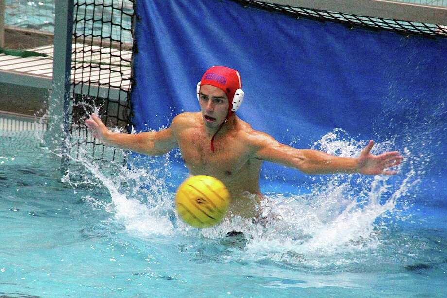 Greenwich High School's Steven Michaud blocks a 5-meter penalty shot against North Allegheny over the weekend. October 2013. Photo: Contributed Photo / Stamford Advocate Contributed