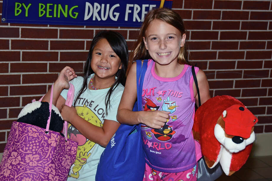 Copeland Elementary School fourth-grade students Dawn Nguyen and Samantha Hagen enjoy the Pajama Jam at Aragon Middle School Sept. 20. Photo: Provided By Cy-Fair Independent School District