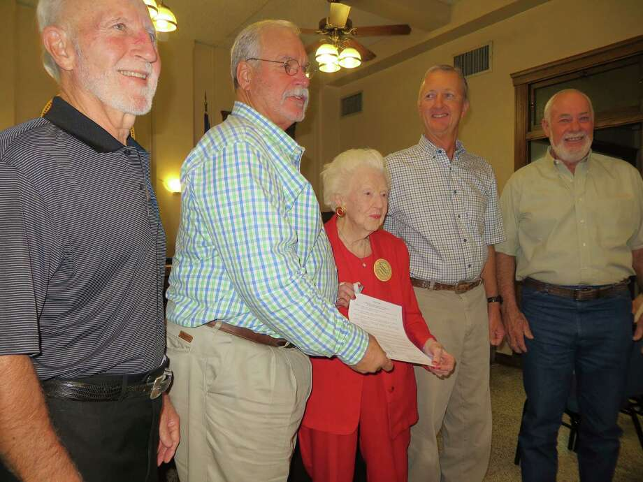 Clarabelle Snodgrass, 100, receives a resolution naming her Kerr County Queen of History from Kerr County Commissioners (l-r) Tom Moser, Buster Baldwin, Jonathan Letz and Bruce Oehler on Oct. 15, 2013. Photo: Zeke MacCormack, San Antonio Express-News / San Antonio Express-News
