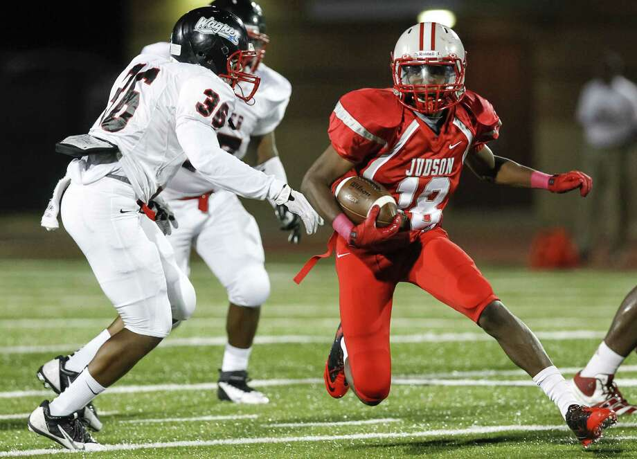 Judson's Malik Taylor (18) looks for running room through Wagner's defense on one of his 13 carries Friday. The Rockets beat their district rival, 47-18, to move to 5-1 on the season.