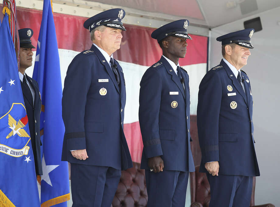 Gen. Mark A. Welsh, chief of staff of the U.S. Air Force (from left), Gen. Edward A. Rice Jr. and Gen. Robin Rand stand at attention during the Air Education and Training Command change of command ceremony and Rice's retirement at Joint Base San Antonio-Randolph Oct. 10.