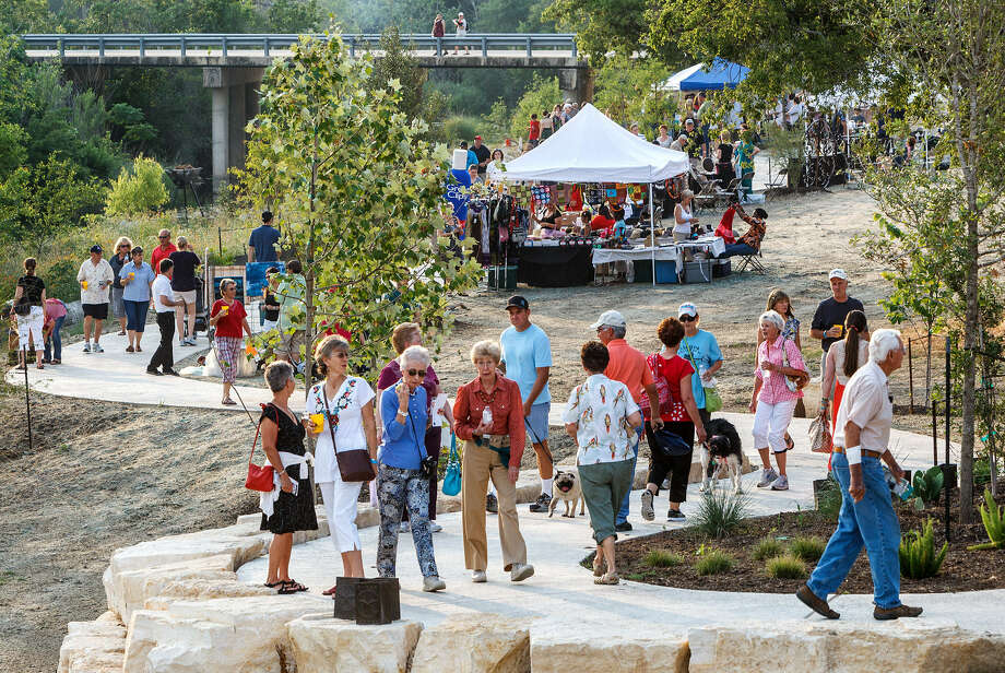 Visitors explore the new Heart of Boerne Trail along Cibolo Creek during the Best of BoerneFest Trail Blaze in May. Local hotel revenues are up 12.7 percent for the first six months of 2013. Photo: Marvin Pfeiffer / Northwest Weekly
