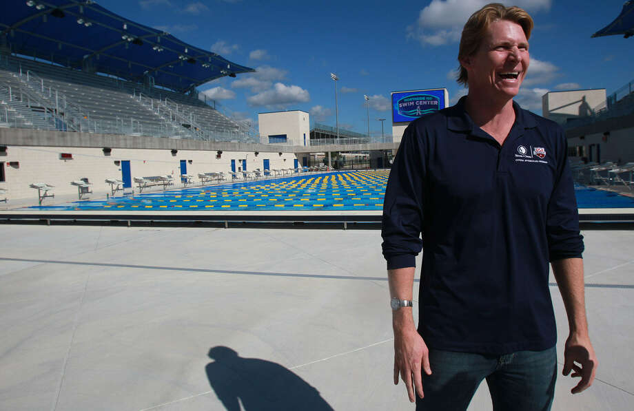 Olympic medalist Josh Davis talks with reporters Oct. 9 at the Northside Swim Center for the announcement of three national swimming events coming to S.A.