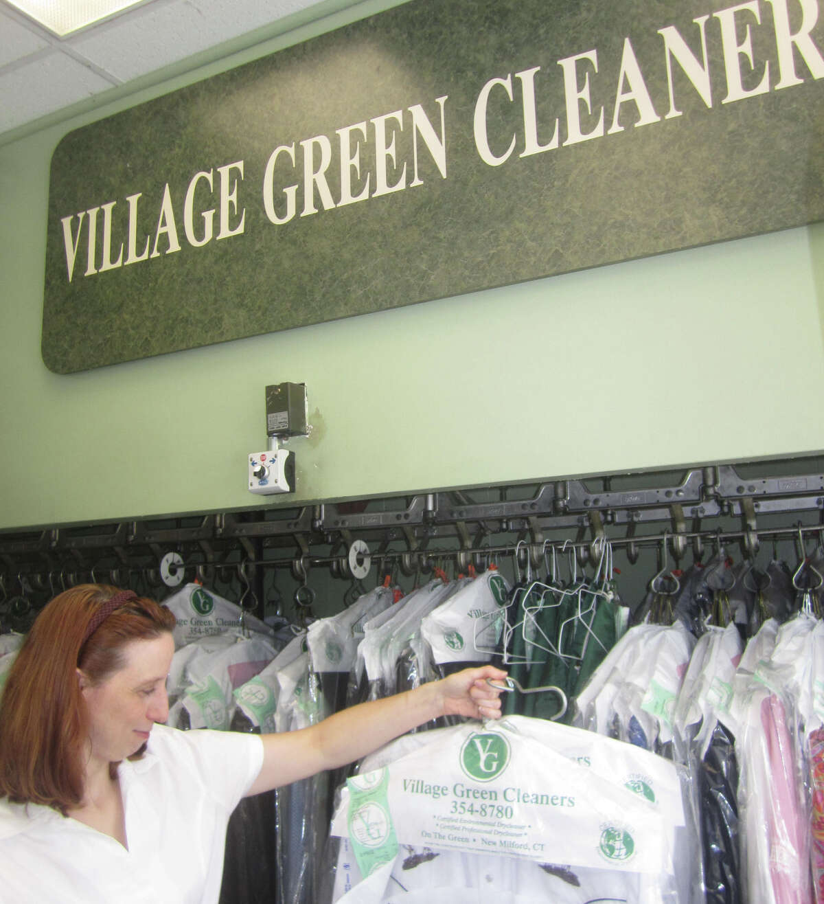 Lynn Potter, a longtime staffer at the Village Green Cleaners in New Milford, is a familiar and friendly face to the shop's many patrons. October 2013