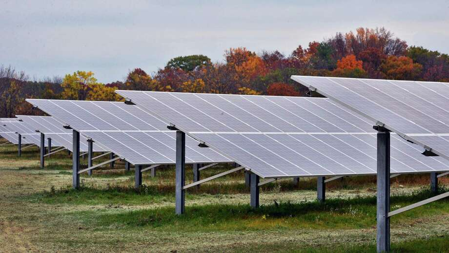 Solar panels at the new 2.7-megawatt solar generation project at Owens Corning's thermal and acoustical insulation plant Tuesday Oct. 15, 2013, in Feura Bush, NY.  (John Carl D'Annibale / Times Union) Photo: John Carl D'Annibale / 00024227A