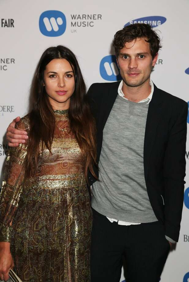 Here's another shot of Jamie Dornan. He is with with Amelia Warner in 2013. He dated Keira Knightley for two years and has modeled. That experience apparently means he's OK with getting naked and sex scenes Photo: Dave M. Benett, Getty Images For Warner Music Gr