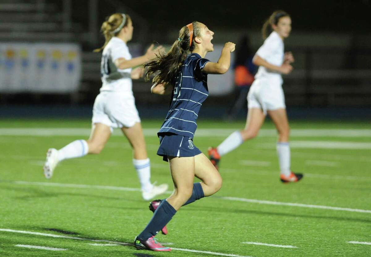Immaculate's Paige Davis celebrates after scoring a goal on a 31 yard direct kick in the SWC girls soccer match between Newtown and Immaculate at Newtown High School in Newtown, Conn. on Tuesday, Oct. 15, 2013.