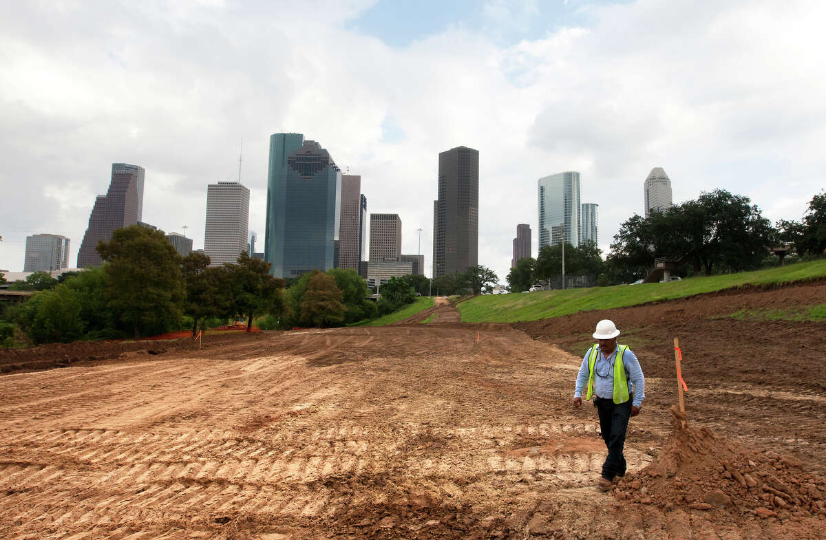 Danny Romero with Millis Development and Construction walks along Buffalo Bayou Park as they work to transform it, Tuesday, Oct. 15, 2013, in Houston. The Buffalo Bayou Partnership has joined with the City of Houston through the Houston Parks and Recreation Department and the Harris County Flood Control District to transform the 160-acre park.