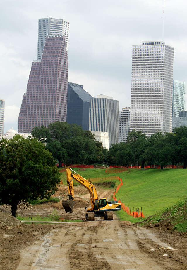 A construction crew works to transform Buffalo Bayou Park, Tuesday, Oct. 15, 2013, in Houston. Photo: Cody Duty, Houston Chronicle / © 2013 Houston Chronicle