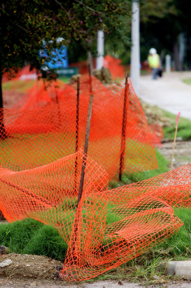 A construction fence is seen as a construction crew works to transform Buffalo Bayou Park, Tuesday, Oct. 15, 2013, in Houston. Photo: Cody Duty, Houston Chronicle / © 2013 Houston Chronicle
