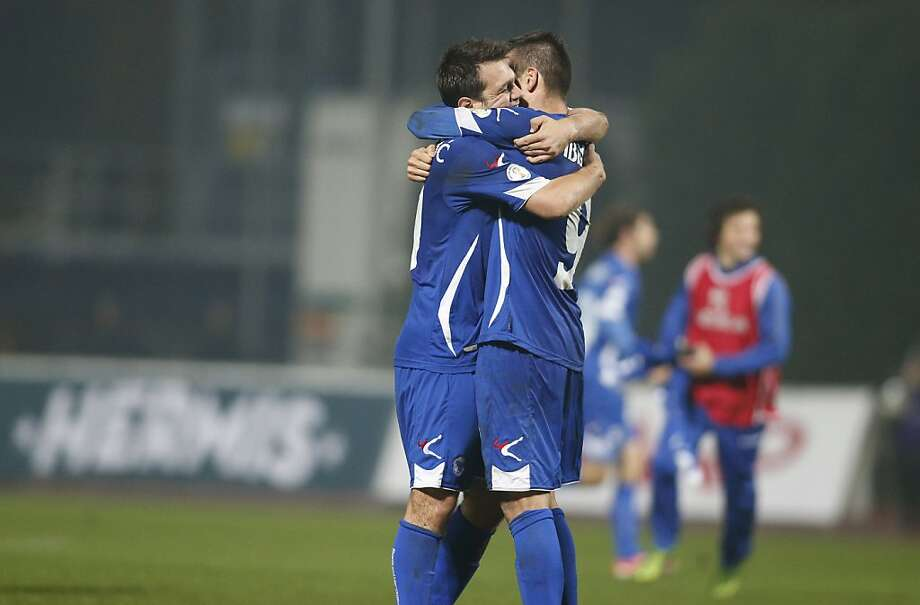 Bosnia's players hug after a goal while qualifying for the World Cup for the first time. Photo: Mindaugas Kulbis, Associated Press