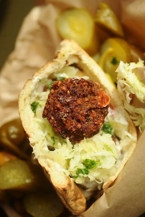A falafel sandwich is one of the menu offerings at Amba, a cafe in Oakland's Montclair district. Photo: Noah Berger, Special To The Chronicle