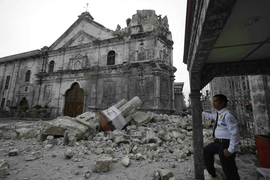 The 16th-century Basilica of the Holy Child in Cebu, the oldest church in the Philippines, lost its bell tower in a magnitude-7.2 earthquake. Other historic churches also were damaged, and wide areas had no power. Photo: Bullit Marquez / Associated Press