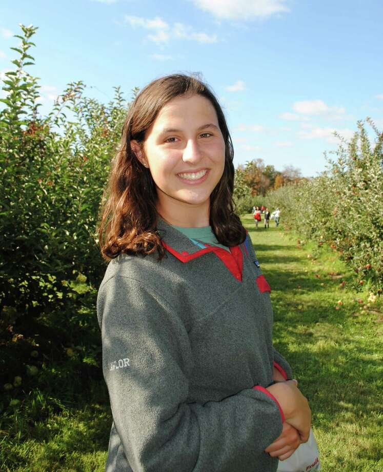 Caroline Lawlor, the apple of the author's eye, during what may --- or may not -- have been her final family apple-picking outing. Photo: Contributed Photo / Fairfield Citizen contributed