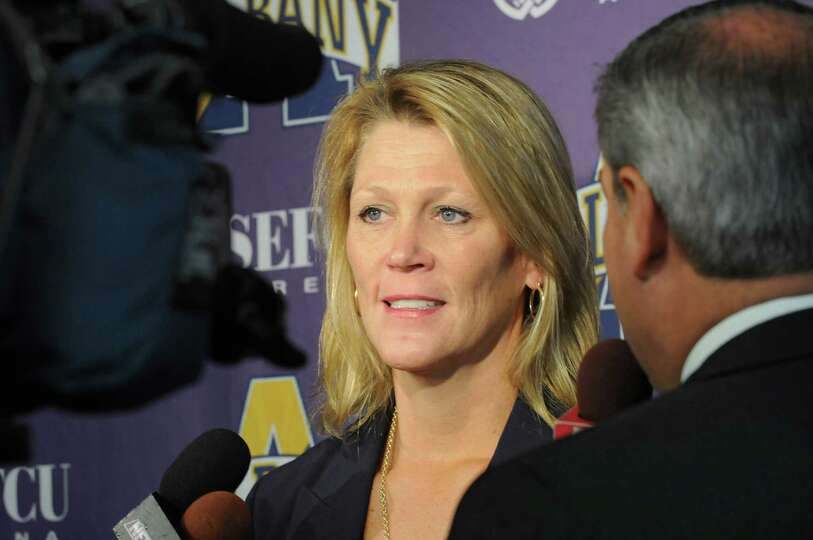 UAlbany women's basketball head coach Katie Abrahamson-Henderson talks with the press during media d