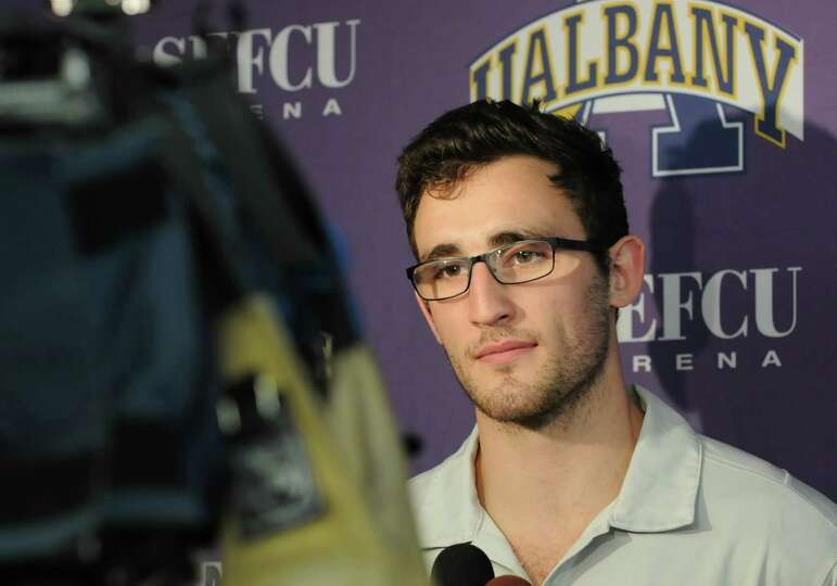 UAlbany men's junior forward Sam Rowley talks with the press during basketball media day at UAlbany