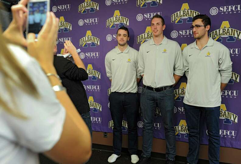 From left, UAlbany men's basketball players Peter Hooley, Luke Devlin and Sam Rowley pose for photos