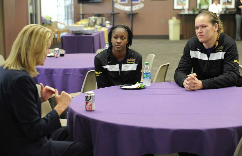 From left, UAlbany women's basketball head coach Katie Abrahamson-Henderson talks with her players Shereesha Richards and Megan Craig during media day at UAlbany on Tuesday, Oct. 15, 2013 in Albany, N.Y. (Lori Van Buren / Times Union) Photo: Lori Van Buren / 00024260A