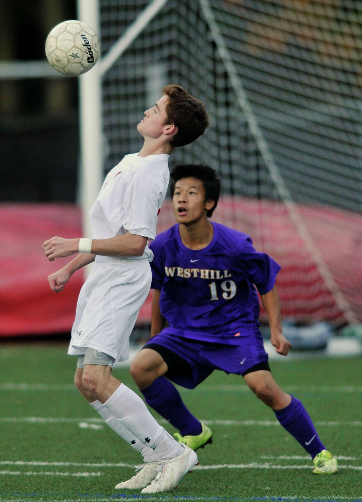 Greenwich's Patrick Santini brings the ball under control while being guarded by Westhill's Charles Teeters during their game at Greenwich High School in Greenwich, Conn., on Tuesday, Oct. 15, 2013. Greenwich won, 2-0.