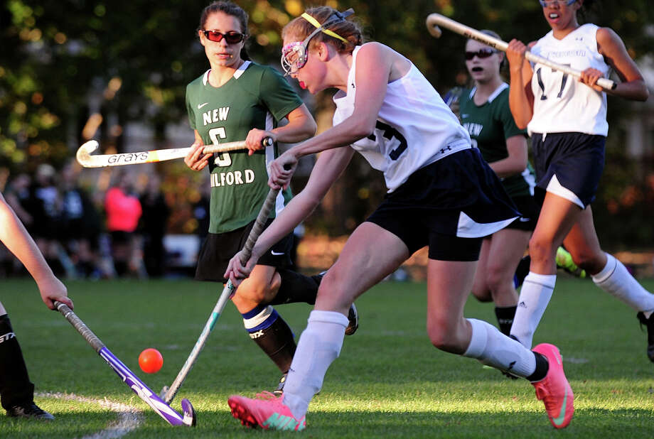Lauralton Hall's Kara Duggan drives the ball towards New Milford's goal, during girls field hockey action in Milford, Conn. on Tuesday October 15, 2013. Photo: Christian Abraham / Connecticut Post