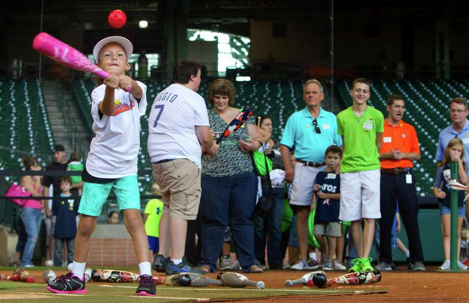Avaya Mora, 6, follows through on a swing during a Sunshine Kids Foundation event at Minute Maid Park, Tuesday, Oct. 15, 2013, in Houston. Photo: Cody Duty, Houston Chronicle / © 2013 Houston Chronicle