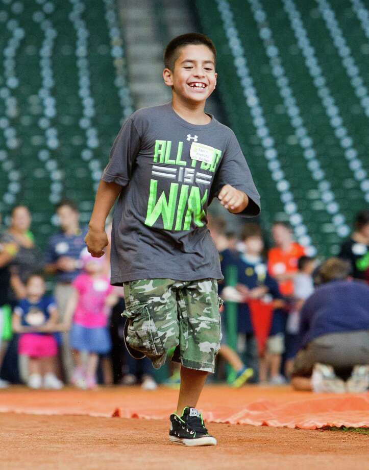 Aaron Vasquez, 9, runs the bases after hitting a baseball during a Sunshine Kids Foundation event at Minute Maid Park, Tuesday, Oct. 15, 2013, in Houston. Photo: Cody Duty, Houston Chronicle / © 2013 Houston Chronicle