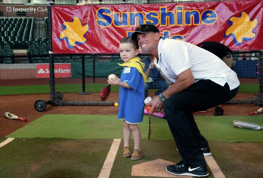 Max McMichael, 3, left, stands with former Astro Craig Biggio, right, as he tells him to look at the big screen during a Sunshine Kids Foundation event at Minute Maid Park, Tuesday, Oct. 15, 2013, in Houston. Photo: Cody Duty, Houston Chronicle / © 2013 Houston Chronicle