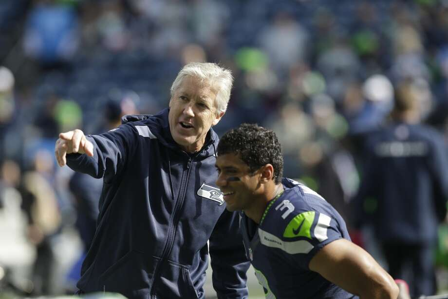 "Q: Were you surprised by how involved Pete Carroll is with the offense?  RW: ""Well, Coach Carroll is so bright-minded in defense, obviously, but also just in every facet of the game -- special teams, offensively and defensively. So just being able to -- I just meet with Coach Carroll every Monday now and just kind of sit with him, and just sit with him for about an hour and just talk football. Just talk about the next opponent and about what they're trying to bring the defense and how we can attack them offensively, just so I can kind of hear his voice and kind of understand what he's thinking. We always talk throughout the game too, as well. Obviously, Coach Bevell and I are really, really close and we communicate every day, and communicate every hour of the day, for the most part. And, same thing with Coach Smith, our quarterback coach.   ""But, whenever I have a chance to sit down with Coach Carroll and just ask about the defense and ask him about the defensive techniques, and what the defensive safeties are doing -- and the linebackers and the corners, as well, what they're trying to do -- I think that really helps me understand the game of football. I'm trying to learn as much as I can. This is only my second year. So as much as I can learn -- in terms of offensively but also defensively, and understand why they're trying to do it, understand the whys of football -- and that helps me play at a higher level, I think."" Photo: Elaine Thompson, Associated Press"