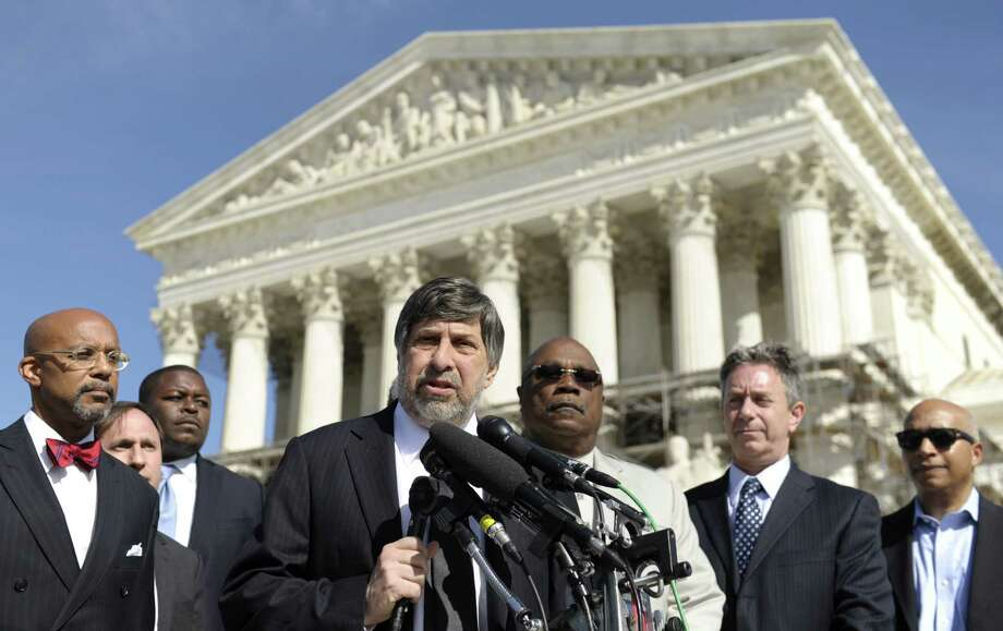 Mark Rosenbaum (center) of the American Civil Liberties Union speaks after arguing a case on affirmative action before the Supreme Court in Washington, D.C. Photo: Susan Walsh / Associated Press