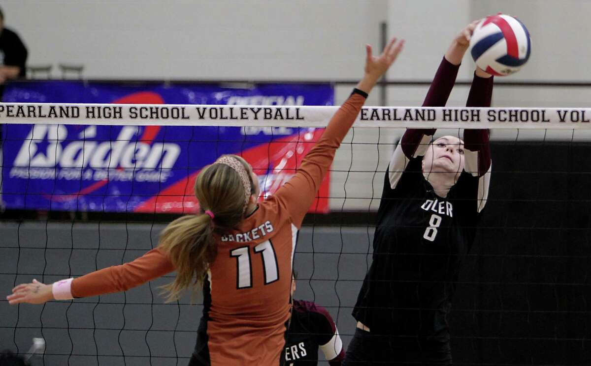 Alvin's Samantha Candrian left, and Pearland's Cassidy Nussman right, during high school volleyball game action at Pearland High School Tuesday, Oct. 15, 2013, in Pearland.