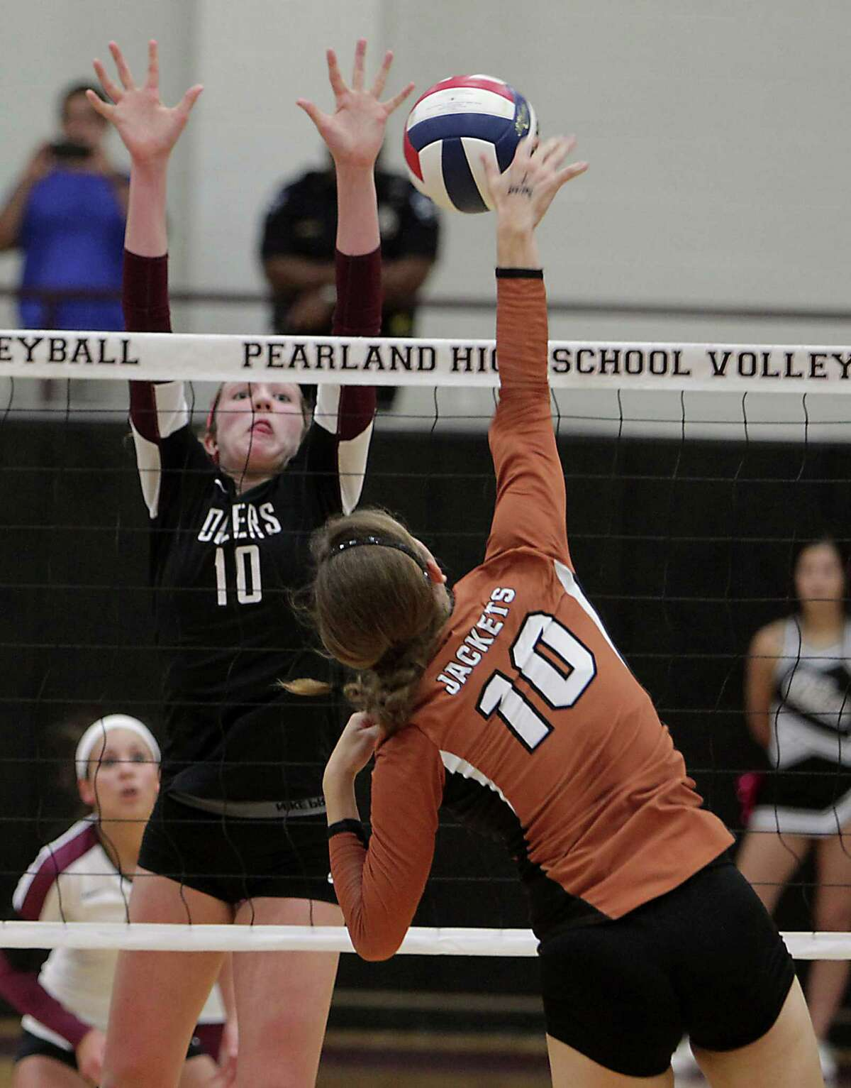 Pearland's Brooke Botkin left, and Alvin's Meagan Graham right, during high school volleyball game action at Pearland High School Tuesday, Oct. 15, 2013, in Pearland.