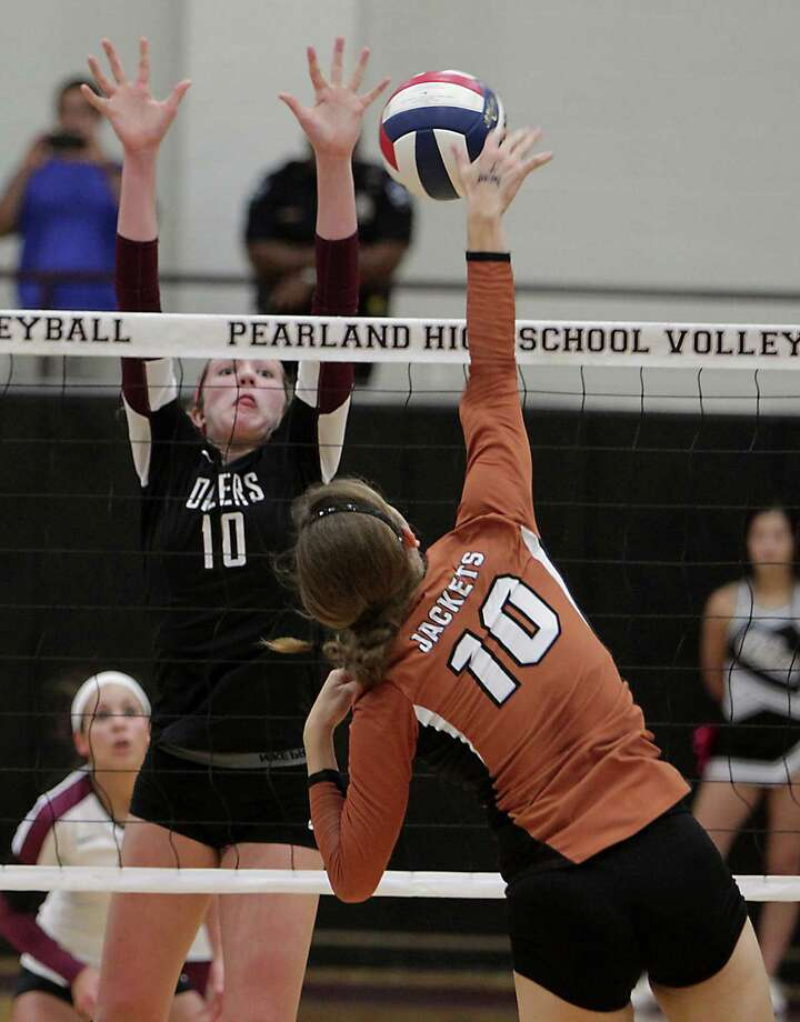 Pearland's Brooke Botkin left, and Alvin's Meagan Graham right, during high school volleyball game action at Pearland High School Tuesday, Oct. 15, 2013, in Pearland. Photo: James Nielsen, Houston Chronicle / © 2013  Houston Chronicle