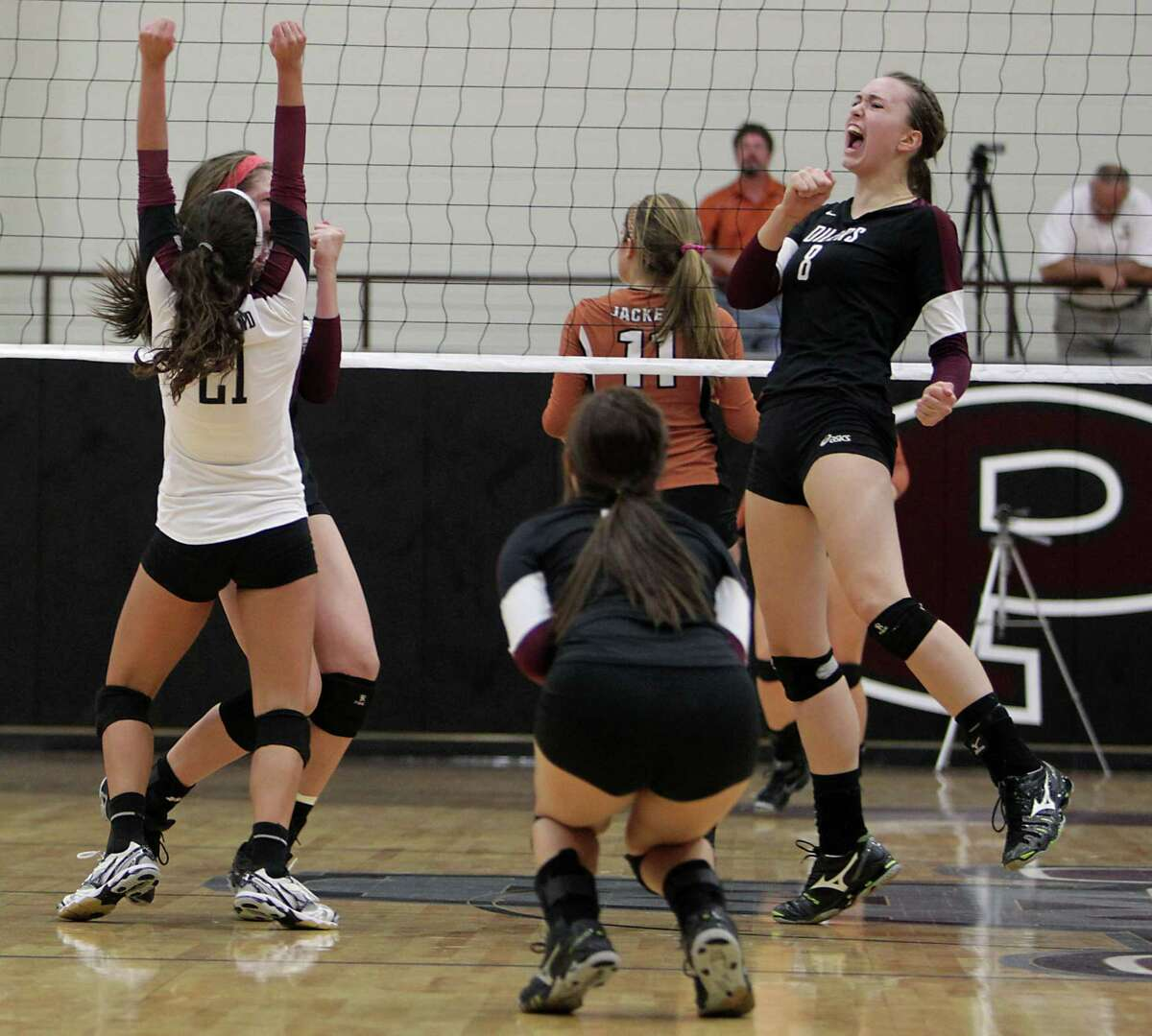 Pearland's Cassidy Nussman right, cheers after Pearland scored a point against Alvin during high school volleyball game action at Pearland High School Tuesday, Oct. 15, 2013, in Pearland.