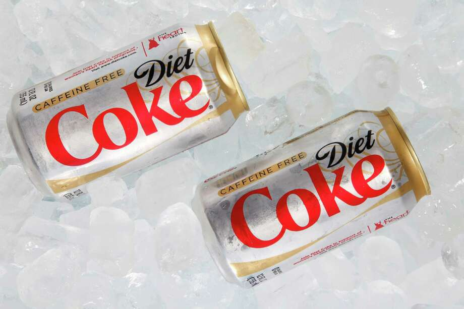 Drinking diet sodaIt may not be sugary, but it still puts bad things in your body and could lead to weight gain.  Photo: Wilfredo Lee, STF / AP