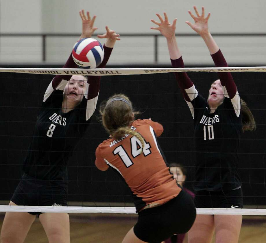 Pearland's Cassidy Nussman left, Alvin's Madison Andrews center, and Pearland's Brooke Botkin right, during high school volleyball game action at Pearland High School Tuesday, Oct. 15, 2013, in Pearland. Photo: James Nielsen, Houston Chronicle / © 2013  Houston Chronicle