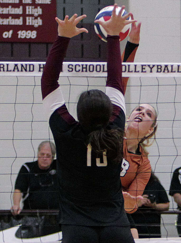 Pearland's Nicole Kirsner left, attempts to block Alvin's Kelsey Purcell right, during high school volleyball game action at Pearland High School Tuesday, Oct. 15, 2013, in Pearland. Photo: James Nielsen, Houston Chronicle / © 2013  Houston Chronicle