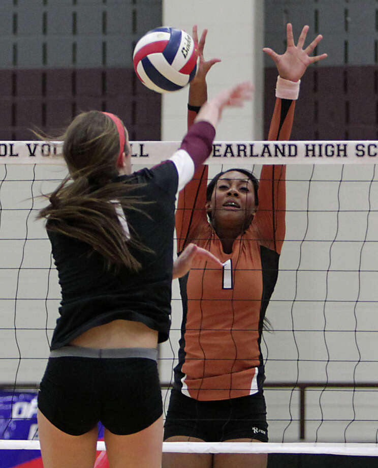 Pearland's Brooke Botkin left, and Alvin's Cholee Holden right, during high school volleyball game action at Pearland High School Tuesday, Oct. 15, 2013, in Pearland. Photo: James Nielsen, Houston Chronicle / © 2013  Houston Chronicle